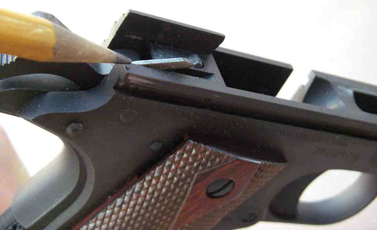 Series 80 pistols received a firing pin block safety that prevents them from firing if dropped on the muzzle. Shown here is the plunger lever, which is a part of the system.