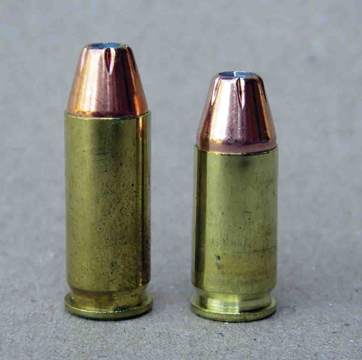 The .38 Super (left) offers a notable powder capacity increase over the 9mm Luger (right), resulting in substantial velocity increases.
