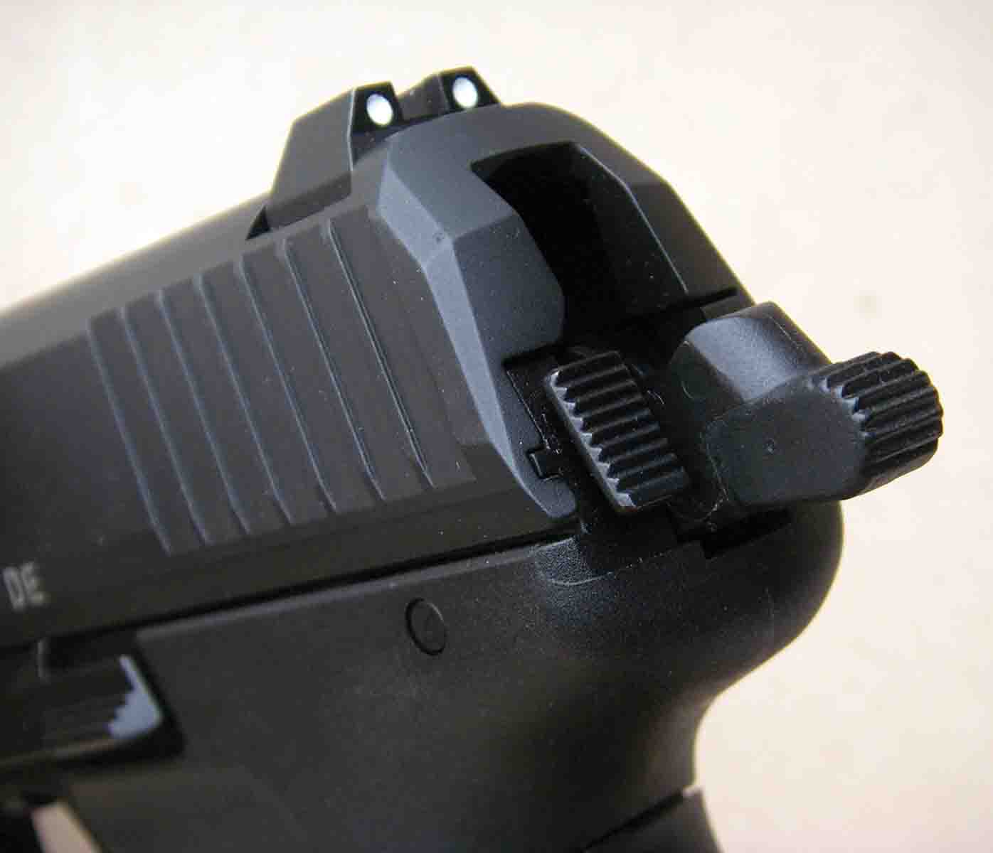 Robust sights are dovetailed into the slide and provide a three-dot system. The decocking button is located to the left of the hammer. Its location also serves to make the sides of the pistol snag free.