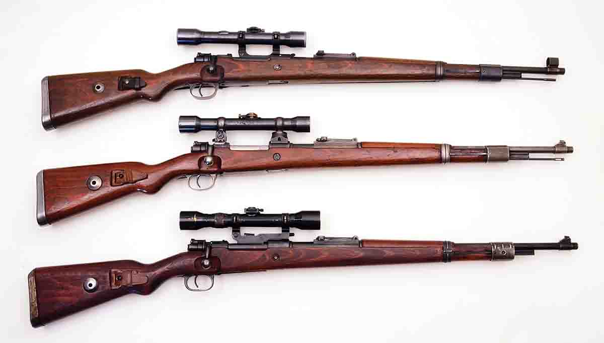 These sniper rifles are more or less original and include (top to bottom): a K98k with a Kahles 4x scope in short side rail mounts, a K98k with a Zeiss 4x scope in low turret mounts and a K98k with a Hensoldt 4x scope in long side rail mounts.