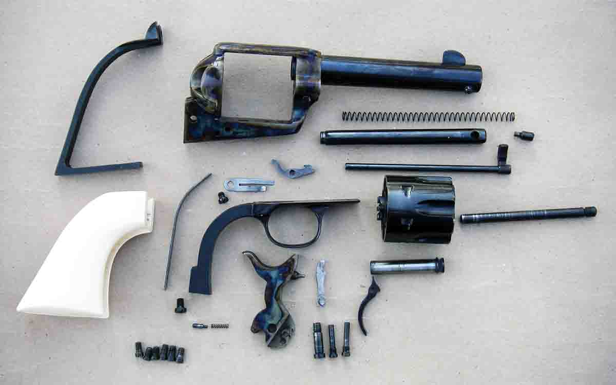 The Great Western II by Pietta disassembled. It is a Colt SAA pattern revolver but features a coil hand spring.