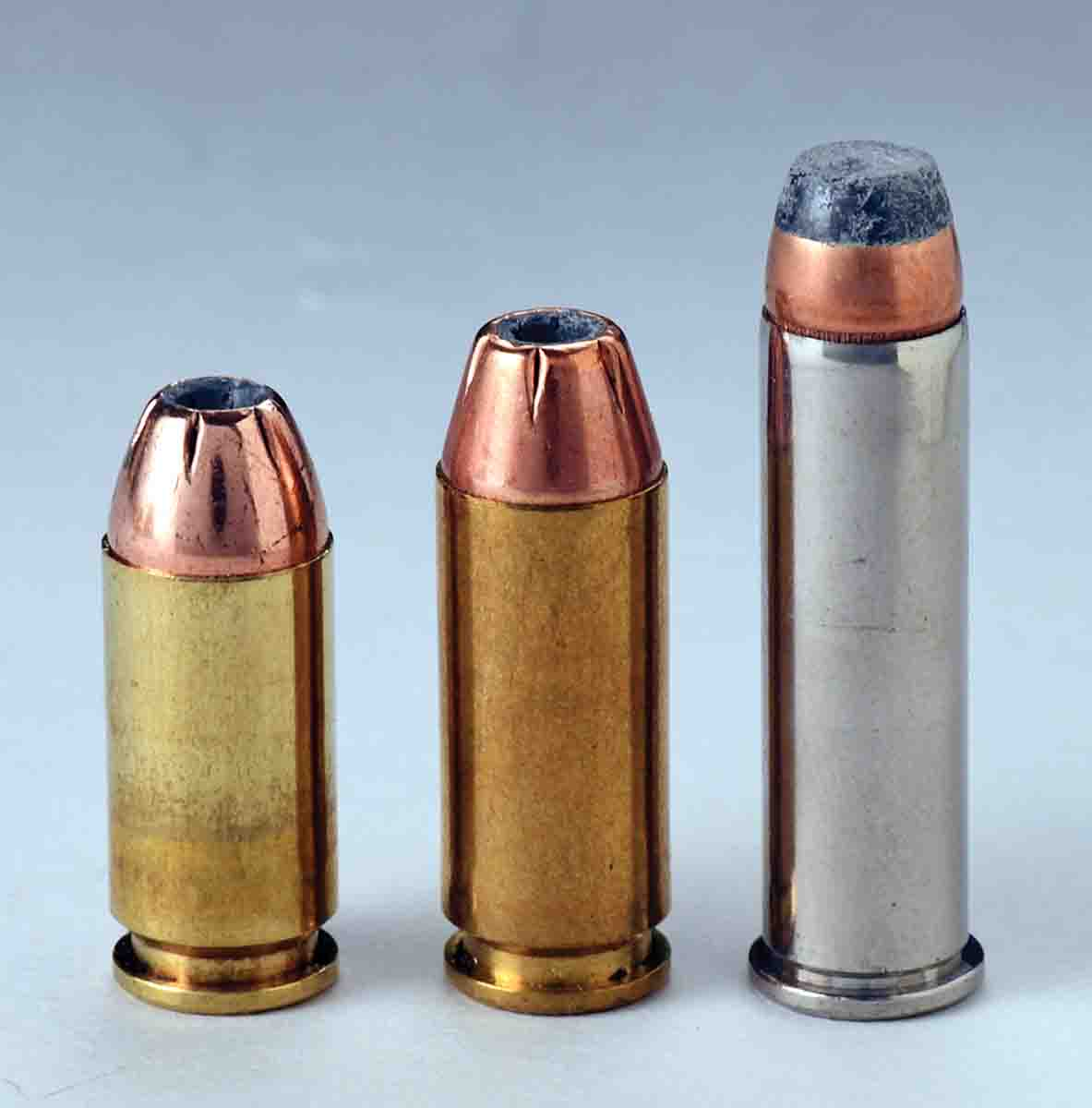 These cartridges include (left to right): a .40 S&W round with no crimp, a 10mm Auto with a light taper crimp  and a .357 Magnum revolver round with a pronounced roll crimp. The .40 and 10mm need a positive case mouth edge exposed for proper headspacing while the rimmed revolver round does not.