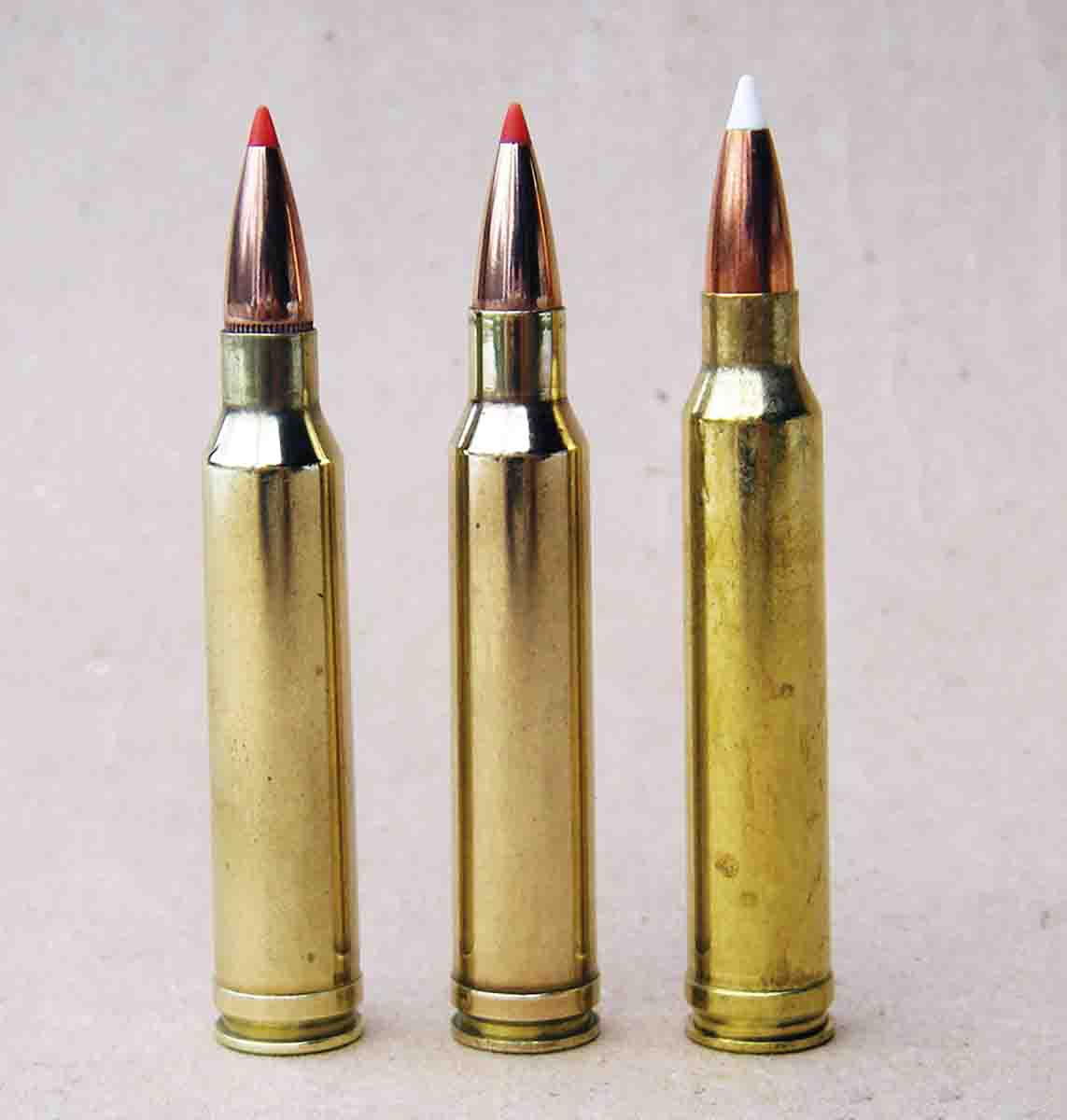 Many people expected Winchester to neck down the .338 Winchester Magnum case to create its .30-caliber magnum. However, Winchester chose to move the shoulder forward and increase powder capacity. Shown from left is the .30-338 wildcat, .308 Norma Magnum and .300 Winchester Magnum.
