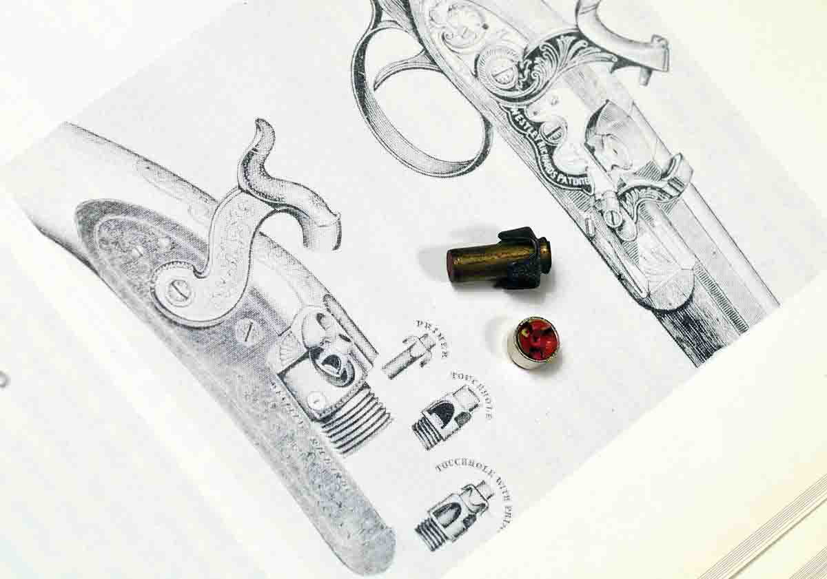 "A tube primer next to a modern Federal Large Rifle primer. The illustration is from an old Westley Richards catalog, reproduced in The Shotgun – History and Development, by Geoffrey Boothroyd (1985). It shows the Westley Richards tube-lock mechanism. The upper illustration is the Westley Richards mechanism for using ""patch"" (paper) primers."