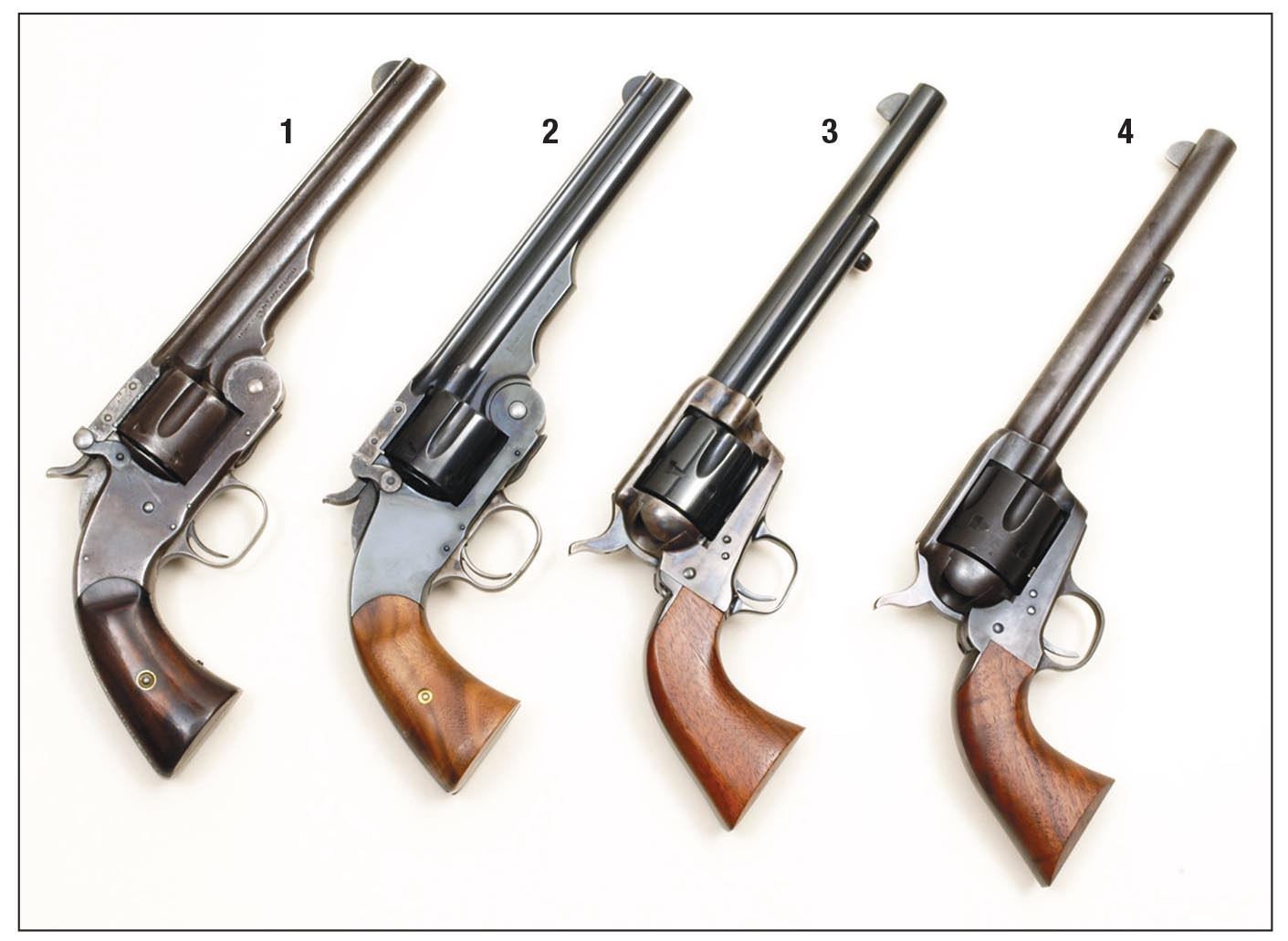 Mike has handloaded .45s for all these revolvers: (1) an original S&W Model No. 3 (Schofield), (2) new S&W Model No. 3 (Schofield), (3) Colt SAA 1873/1973 Commemorative and a (4) U.S. Firearms Custer Battlefield .45.
