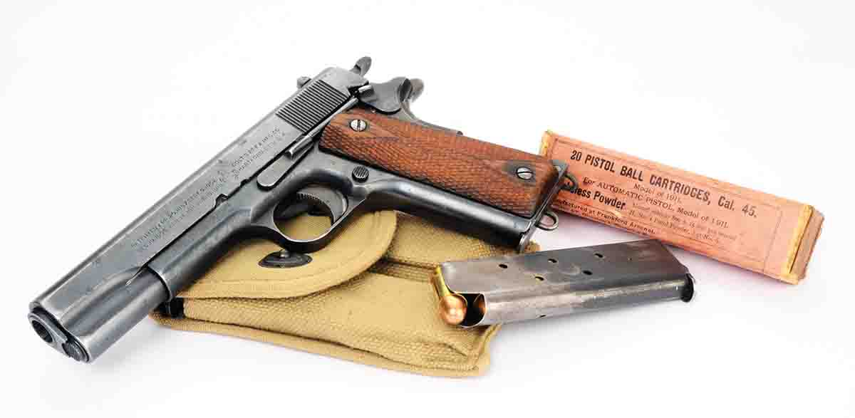 A Colt Model 1911 of 1918 vintage with a box of .45 Auto dated 1915. Velocity is rated at 800 fps.