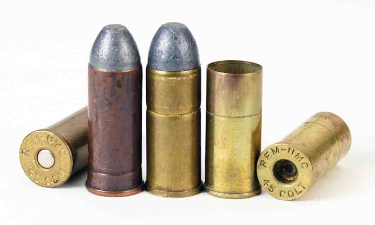 The two loaded cartridges at left are Remington-UMC .45 S&W and U.S. Government .45 S&W (Schofield). The cartridge at right is a Remington-UMC .45 Colt round with fired Remington-UMC short .45 cases.
