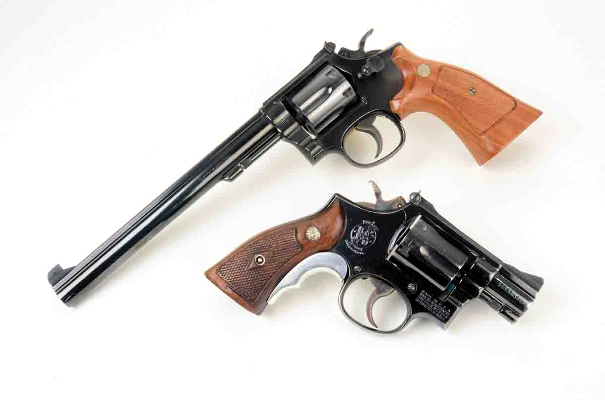 The long and short of Smith & Wesson .38 Special revolvers. At top is a Model 14 (aka K38) with an 83⁄8-inch barrel. Below it is a Model 15 (aka Combat Masterpiece) with a 17⁄8-inch barrel.