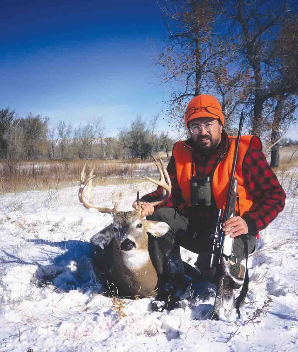 The 7mm Remington Magnum works very well as an all-around cartridge for both deer and larger game. John shot this whitetail buck in 1991 with a Browning A-Bolt.
