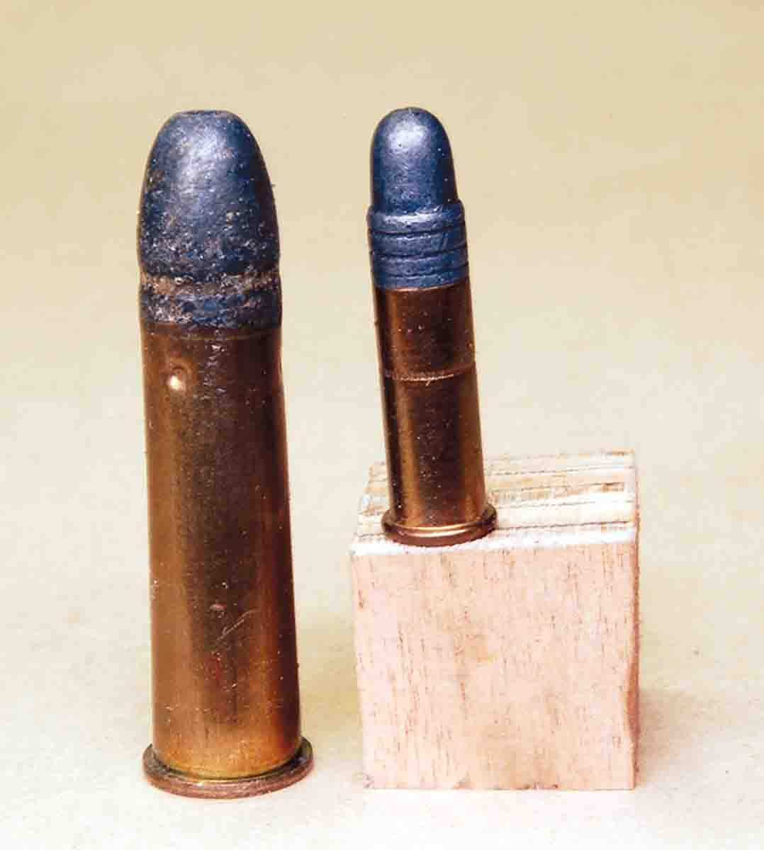 The .310 Cadet used an outside lubed bullet (left) just like the .22 rimfire (right).