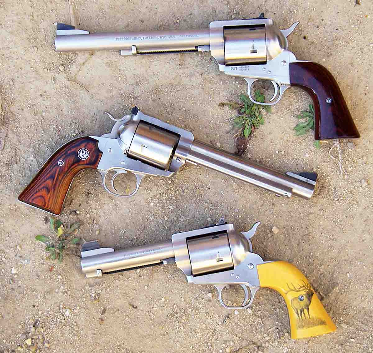 Typical revolvers chambered for the .454 Casull include (top to bottom) a Freedom Arms Model 83 with a 7½-inch barrel, a Ruger New Model Super Blackhawk Bisley with a 6½-inch barrel and a custom Freedom Arms Model 83 with a 4¾-inch barrel.