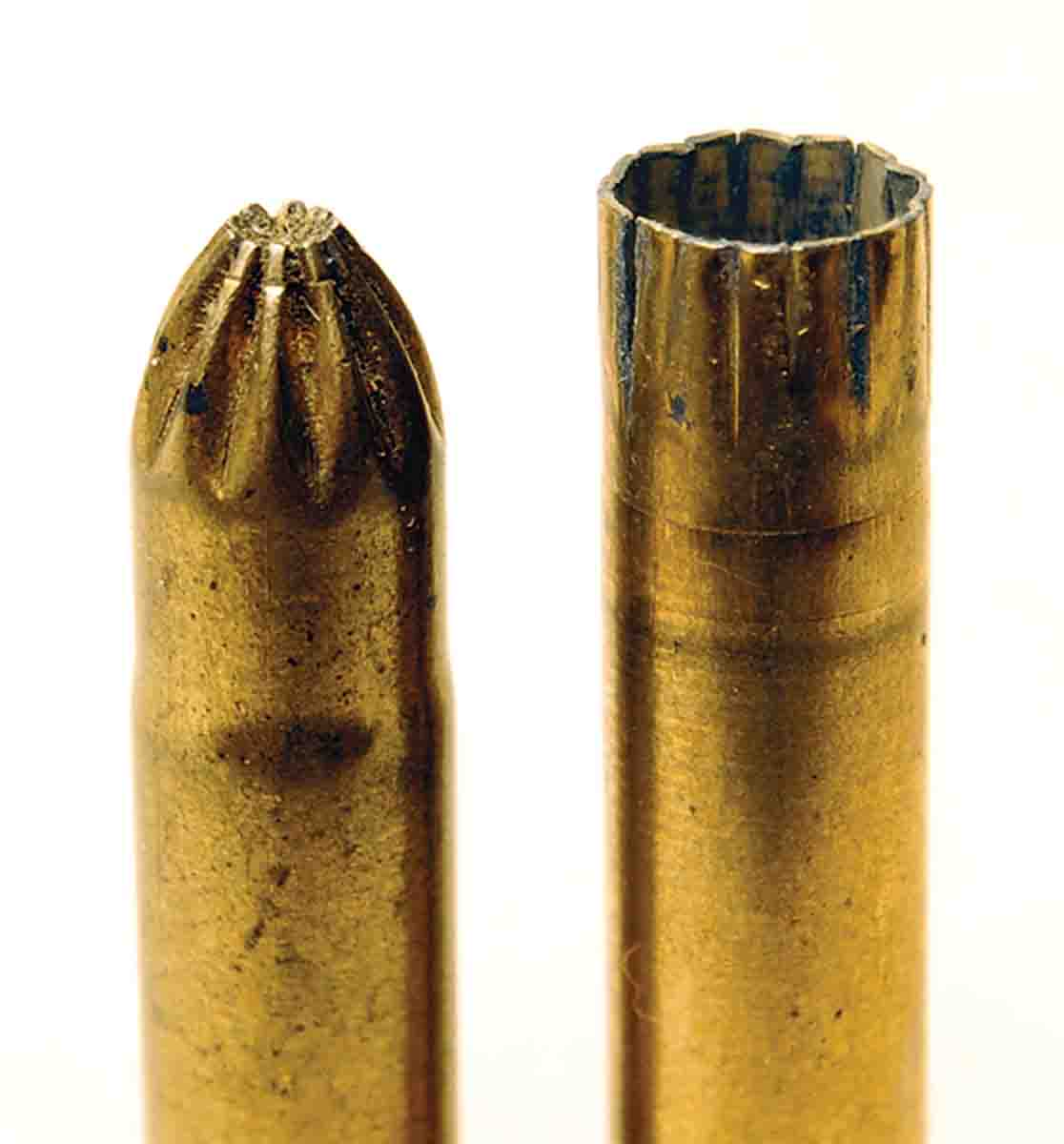 A close-up of a modern rose crimp and a fired shot cartridge, which shows that the crimp does open fully to release shot.