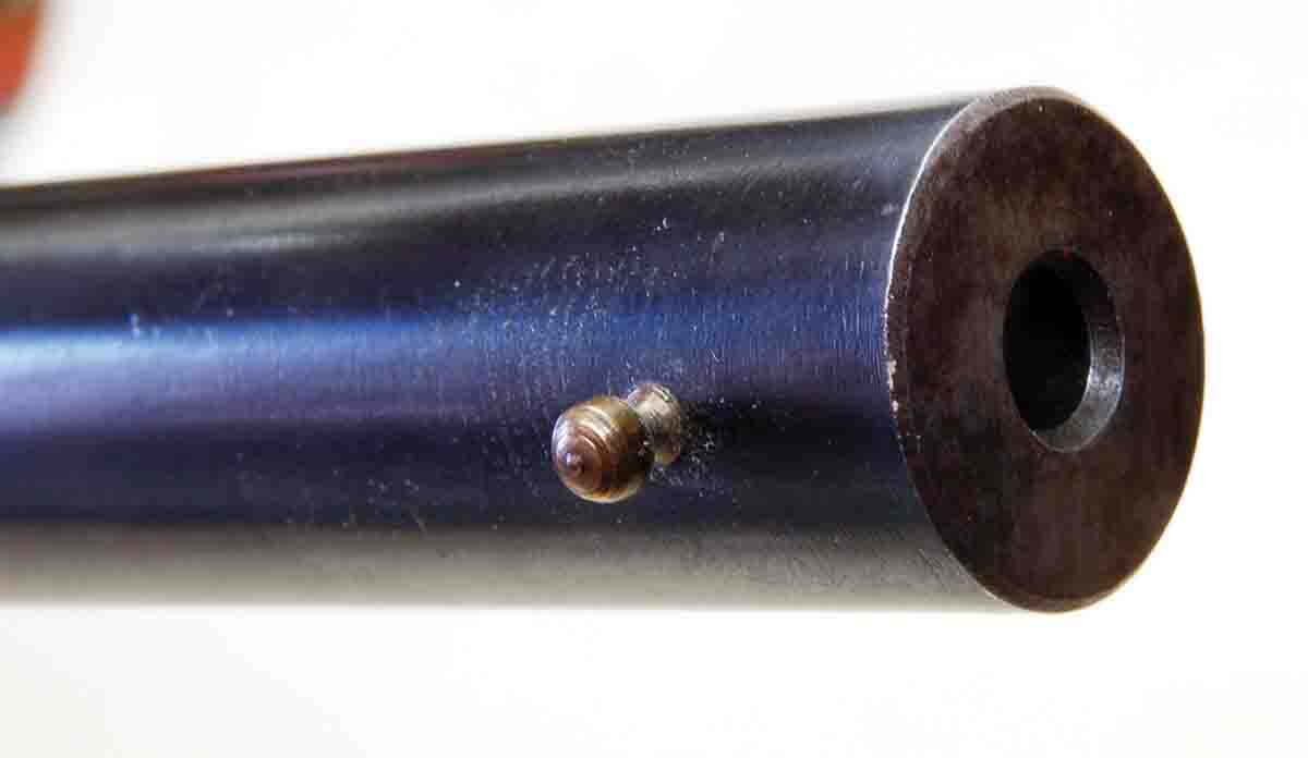 The muzzle of a Stevens smoothbore uses a normal barrel diameter and a brass bead shotgun sight.