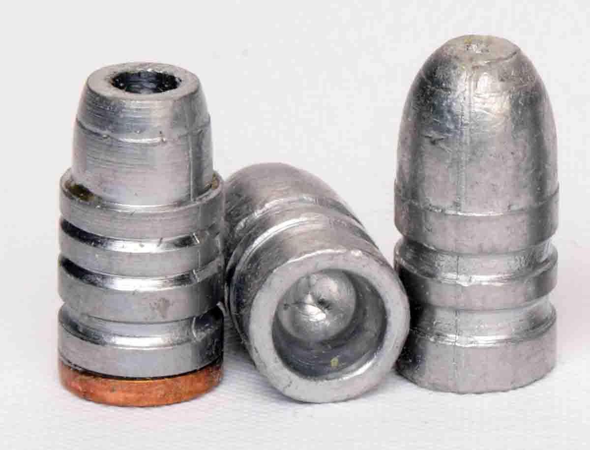 The hollowpoint, gas check cast bullet at left is from Lyman mould 358156HP. The hollowbase bullet at right is from a Rapine mould 145358HB. Both bullet designs are .38/.357 but are now unavailable.