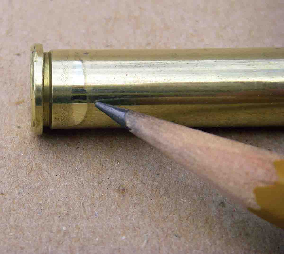 Some lever-action rifles feature a chamber with a bevel to facilitate feeding, which can leave a bulge just forward of the head. This must be removed to assure reliable chambering of handloaded cartridges.