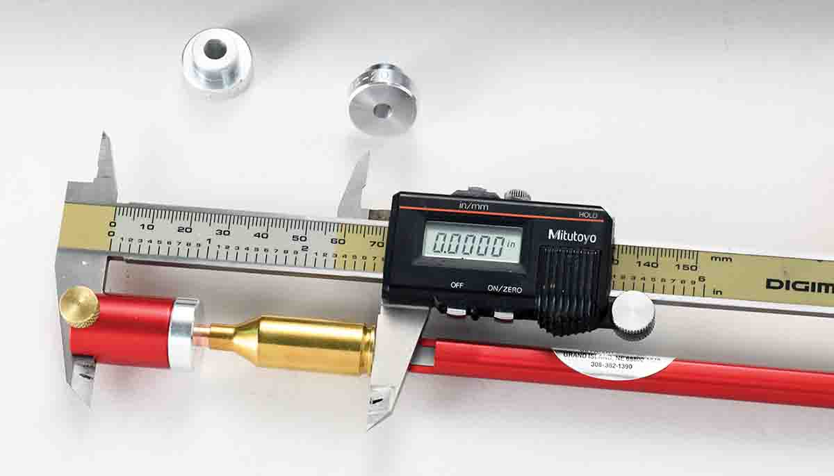 Inserts for various bullet diameters allow measurements to be taken on the bullet's ogive if desired. In this instance, the measurement is zeroed on the caliper.