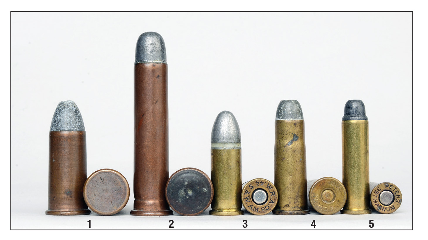 A variety of primers have been used through the years: (1) Rimfire .56-50 Spencer, (2) internal primed .45 Government, (3) the first reloadable revolver cartridge .44 Smith & Wesson American, (4) small primer in .38 WCF (.38-40) and (5) large pistol primer in .357 Smith & Wesson Magnum.