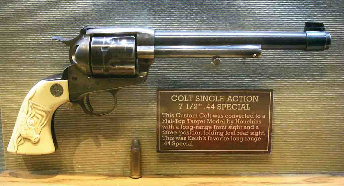 This 1917-era Colt Single Action Army .44 Special features a 71⁄2-inch barrel, Smith & Wesson adjustable rear sight, barrel band with gold bars on Patridge-style front blade sight, King short-action conversion and carved ivory stocks.