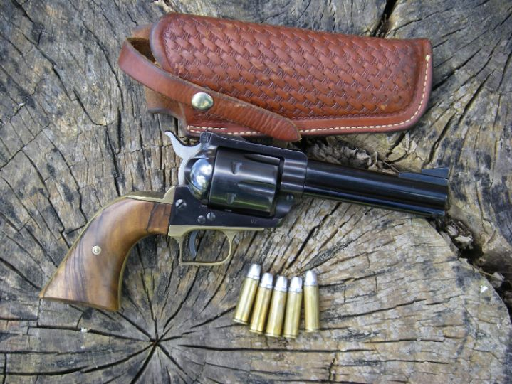 This early Ruger Blackhawk .41 Magnum with serial number 67 was owned by Elmer Keith, who was the driving force in convincing Smith & Wesson, Bill Ruger and Remington to work together and develop this cartridge.  It features a Super Blackhawk style brass grip frame, custom stocks and is shown with an original George Lawrence Keith designed 120 holster. Keith took many large Idaho jackrabbits (a pest) and mule deer with this outfit.  The revolver is capable of top accuracy and often produces ragged, one-hole groups at 25 yards, naturally with Keith bullets.
