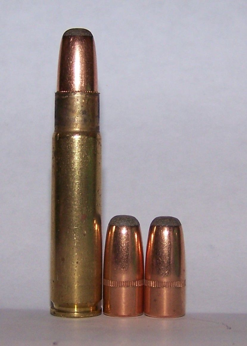 The cartridge at left illustrates the proper overall length for the .35 Remington just before crimping.